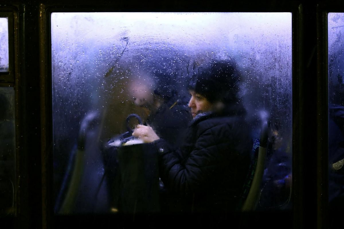 A woman looks on as she sits in a bus at rush hour during a cold spell in London, Britain, on Jan 22, 2019.