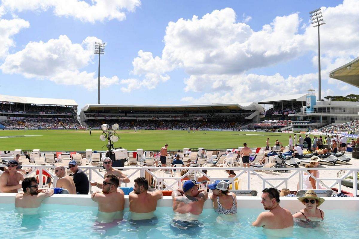 Fans watch a cricket match from the beach area during day one of the First Test match between England and West Indies at Kensington Oval in Bridgetown, Barbados, on Jan 23, 2019.