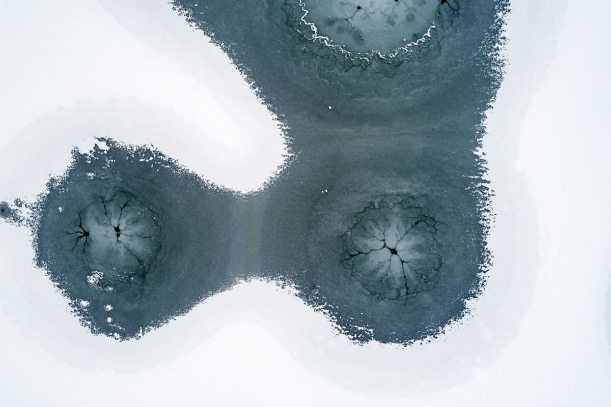A picture taken with a drone shows the frozen and snow-covered Lake Pecs at Orfu, Hungary, on Jan 23, 2019.