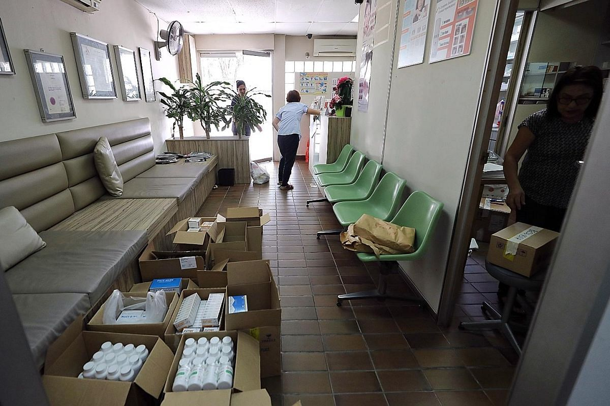 Staff packing items into boxes yesterday. The clinic is moving to Royal Square Medical Suites in Novena, where it will open with a new name: Lily Neo Clinic. The clinic was one of the last few outlets still operating in its block ahead of a 2021 dead