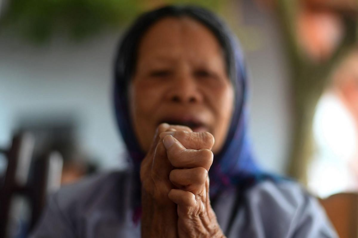 A leprosy survivor offering prayers on the 15th day of the lunar month at a pagoda in the Van Mon Leprosy Hospice compound on Jan 20, 2019.