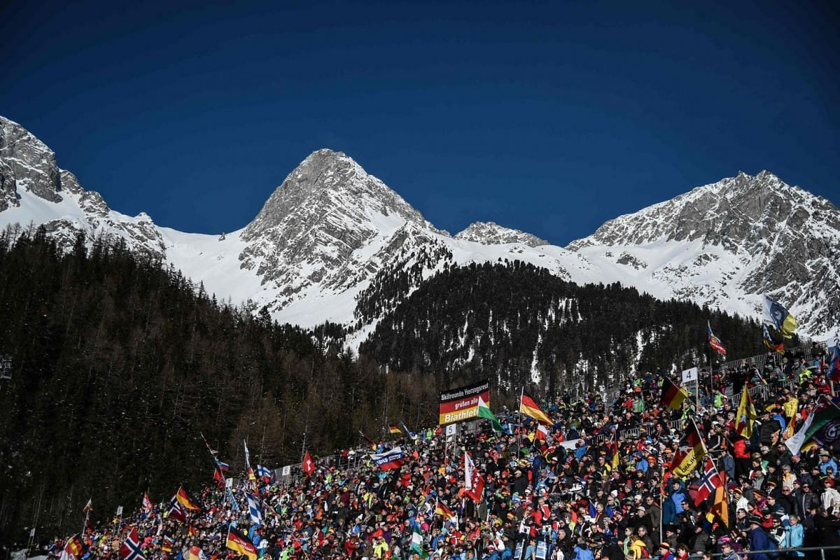 Spectators cheer during the women's 7.5km sprint event of the IBU Biathlon World Cup in Rasen-Antholz (Rasun Anterselva), Italian Alps, on Jan 24, 2019.