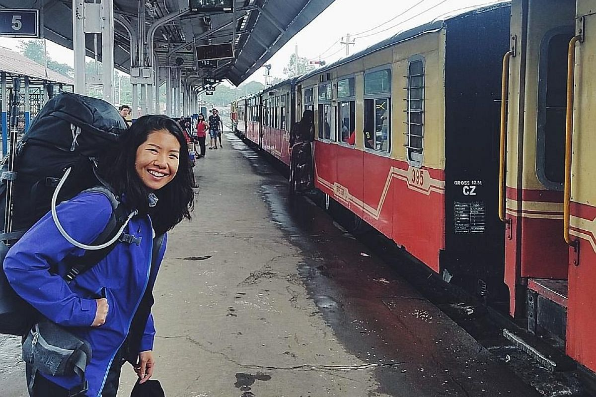 """It's all about managing money well, such as cooking and eating in and going out only during the weekends. I spend more living in Singapore than I do travelling.'' MS MELISSA NG, owner of digital design studio Melewi (above, during a trip to India last ye"