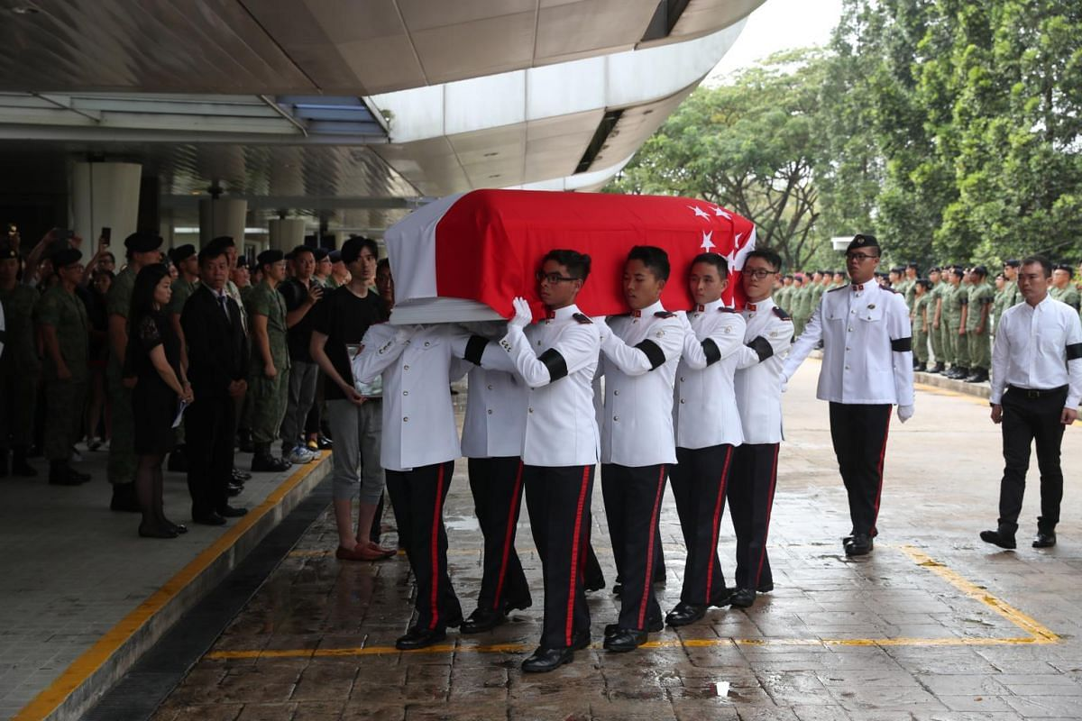 SAF personnel carrying the coffin of CFC (NS) Aloysius Pang into Mandai Crematorium, during his military funeral, on Jan 27, 2019.