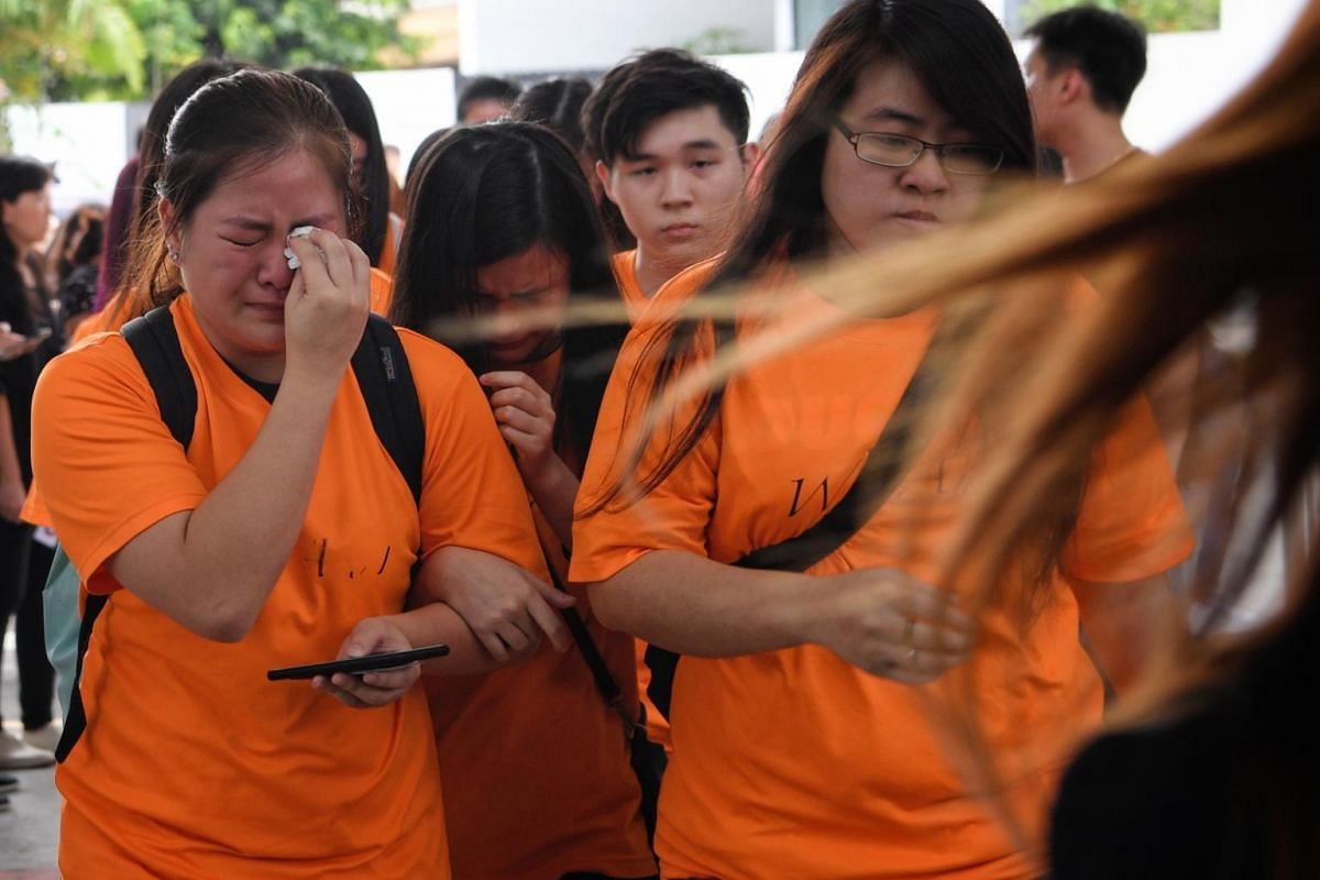 Members of Aloysius Pang's fan club Pangsters tearing up as they prepare to pay their respects at his wake on Jan 26, 2019.
