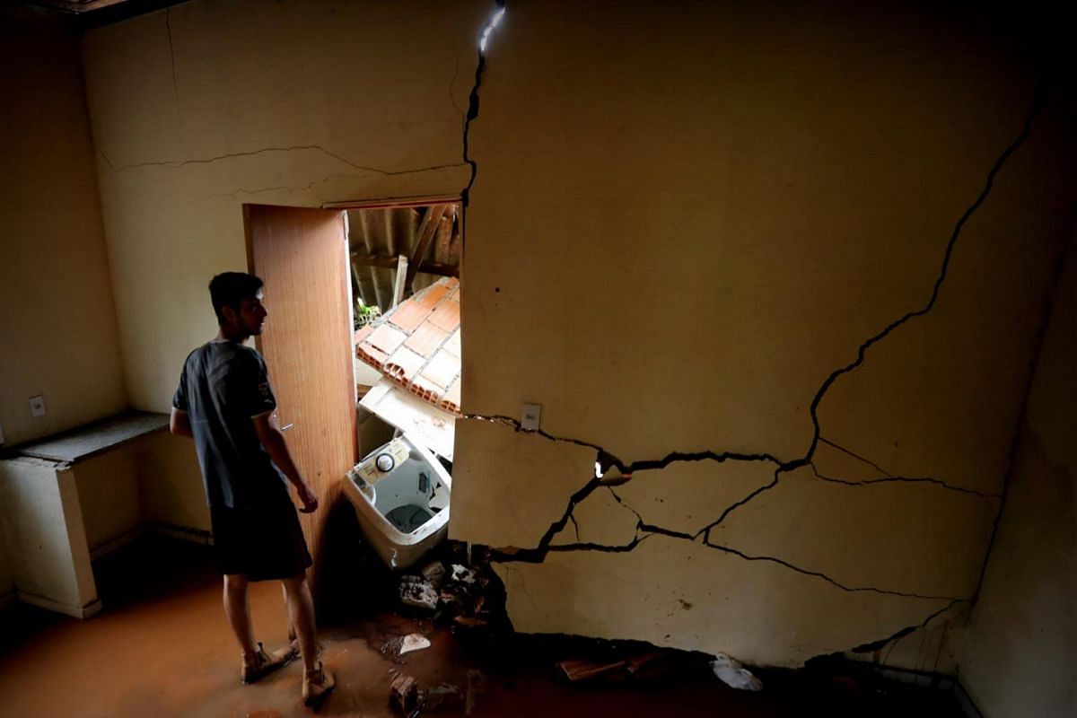 A man observes the damage to his house after the breaking of a dam in Brumadinho, on Jan 26, 2019.