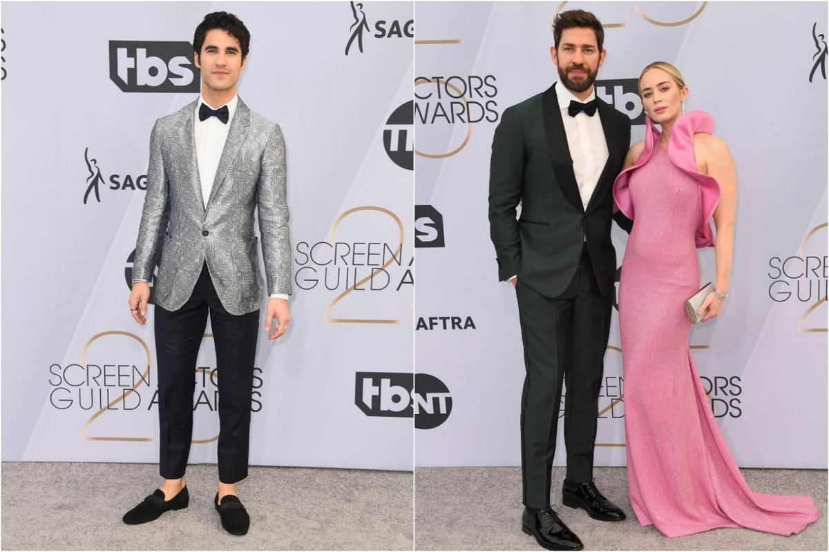 The Assassination Of Gianni Versace actor Darren Criss (left), and John Krasinski with wife Emily Blunt.