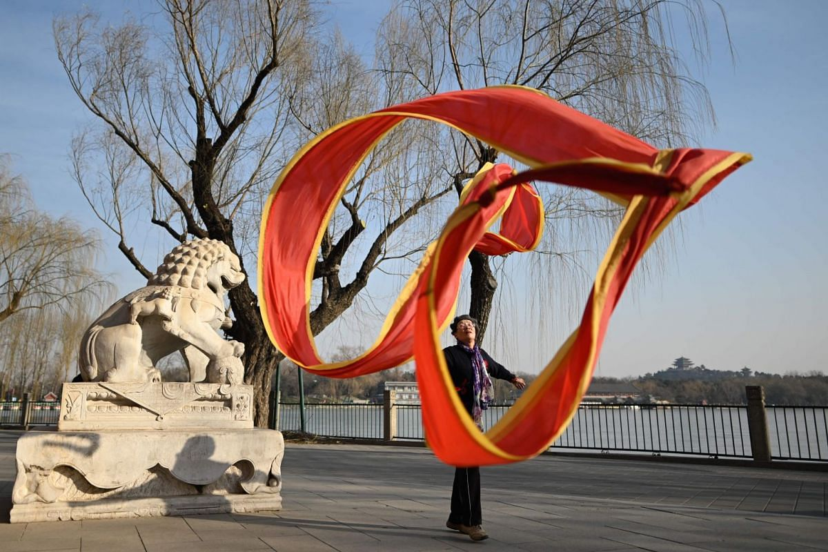 An elderly woman dances with a ribbon at a park in Beijing on January 28, 2019. PHOTO: AFP