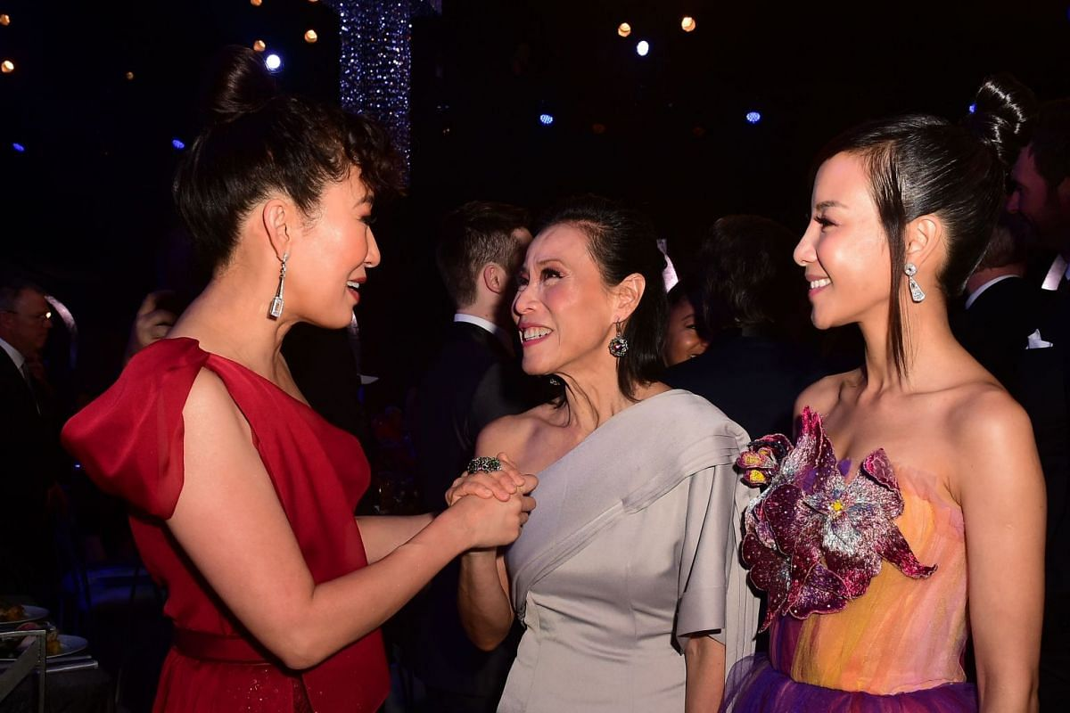 (From L) Actresses Sandra Oh, Tan Kheng Hua and Fiona Xie attend the 25th Annual Screen Actors Guild Awards show at the Shrine Auditorium in Los Angeles on January 27, 2019. PHOTO: AFP
