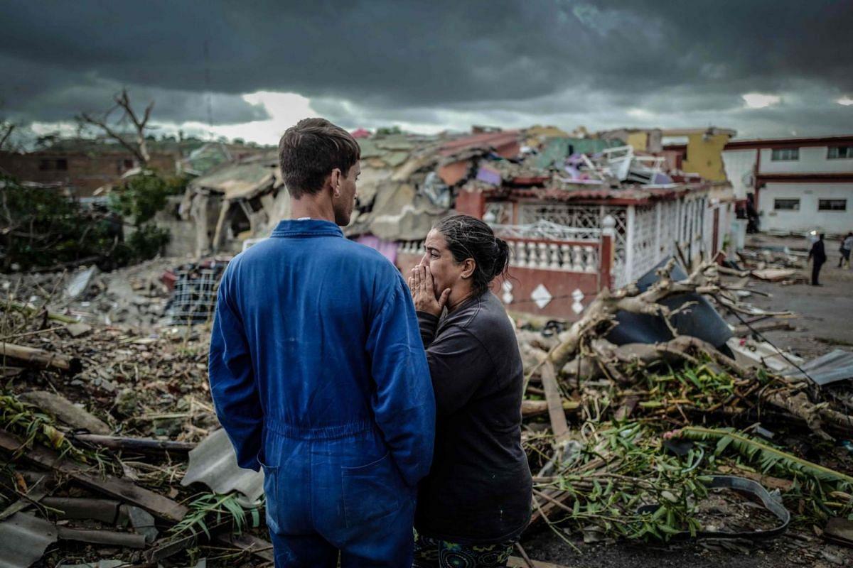 A resident of tornado-hit Regla neighbourhood cries in front of her destroyed house in Havana on Jan 28, 2019.