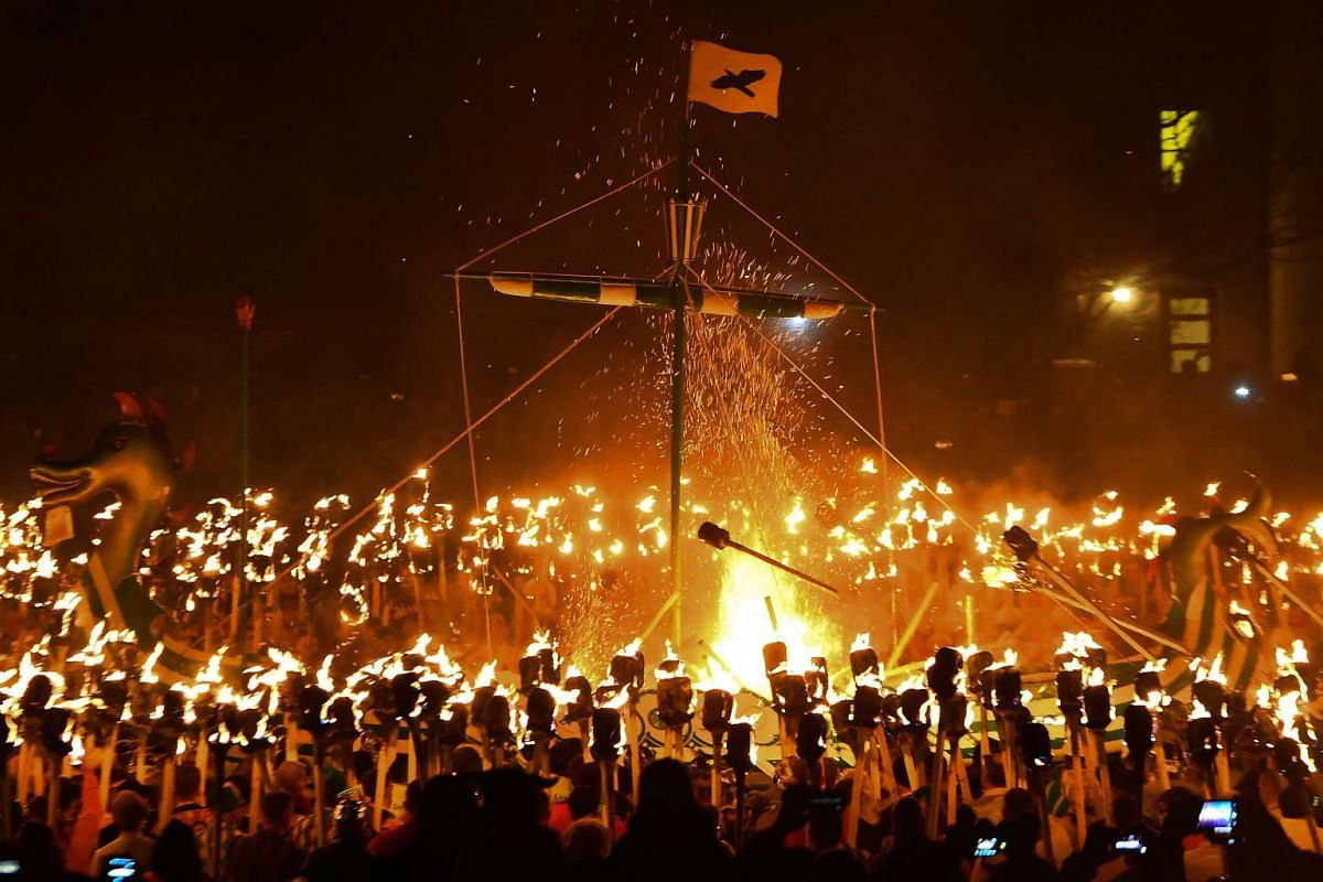 Guizers dressed as Vikings from the Jarl Squad set fire to the longship with burning brands as they take part in the Up Helly Aa festival in Lerwick, Shetland Islands on January 29, 2019. PHOTO: AFP