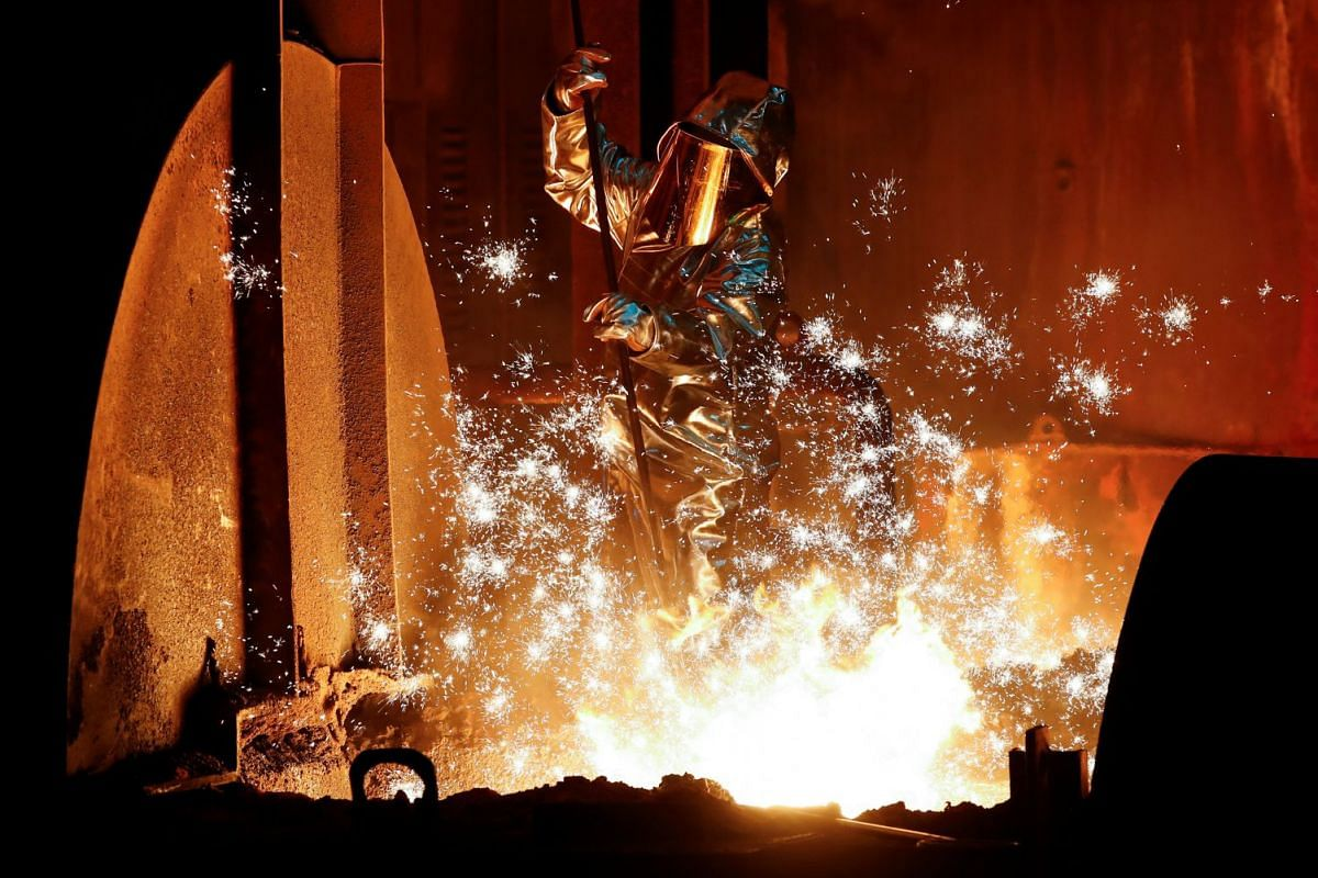 A steel worker of Germany's industrial conglomerate ThyssenKrupp AG takes a sample of raw iron from a blast furnace at Germany's largest steel factory in Duisburg, Germany on January 28, 2019. PHOTO: REUTERS