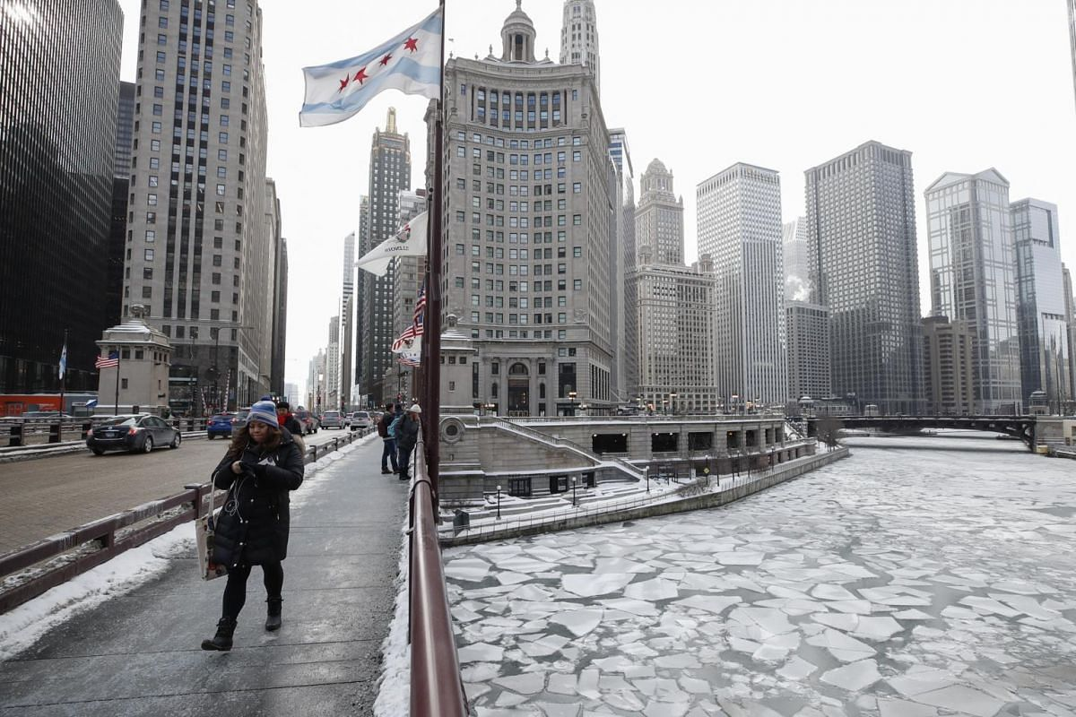 A woman walks along Michigan Avenue above the frozen Chicago River in Chicago, Illinois, on Jan 29, 2019.