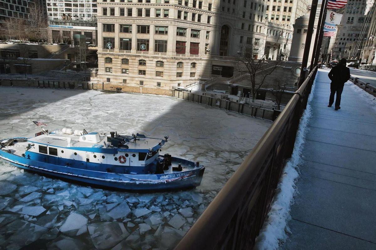 The James Versluis breaks ice on the frozen Chicago River on Jan 30, 2019 in Chicago, Illinois.