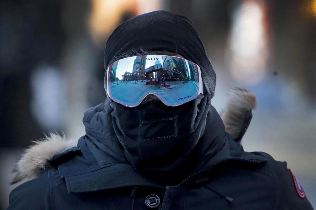 A commuter walks through downtown in sub-zero temperatures during an extremely light morning rush hour on Jan 30, 2019 in Chicago, Illinois.
