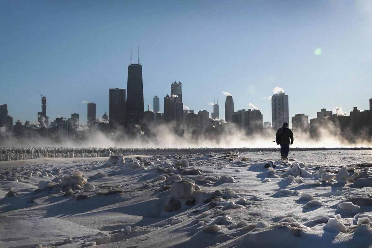 A man walks along the lakefront as temperatures hovered around -20 degrees on Jan 30, 2019 in Chicago, Illinois.