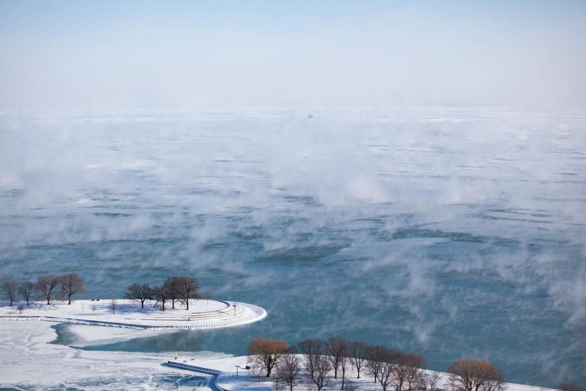 Sea smoke, the result of extremely cold air blowing over warmer water, rises from Lake Michigan in Chicago, on Jan 30, 2019.