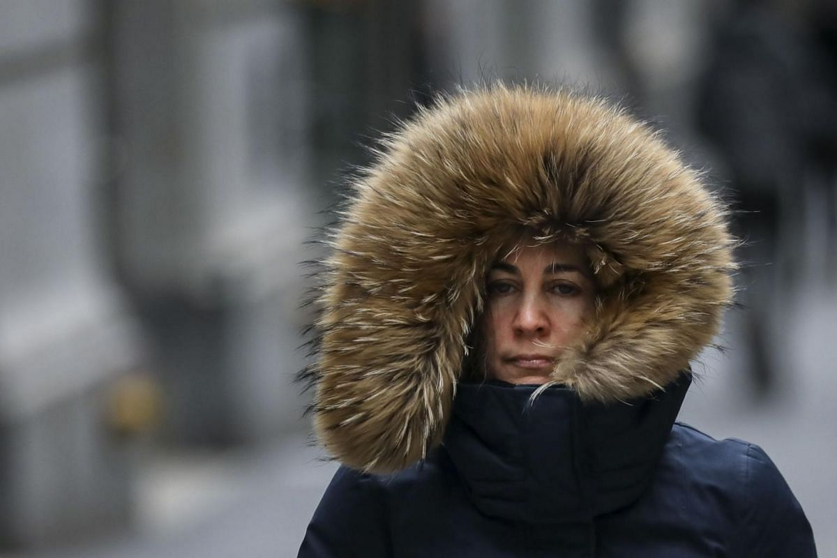 A bundled-up woman walks through the Financial District, on Jan 30, 2019 in New York City.