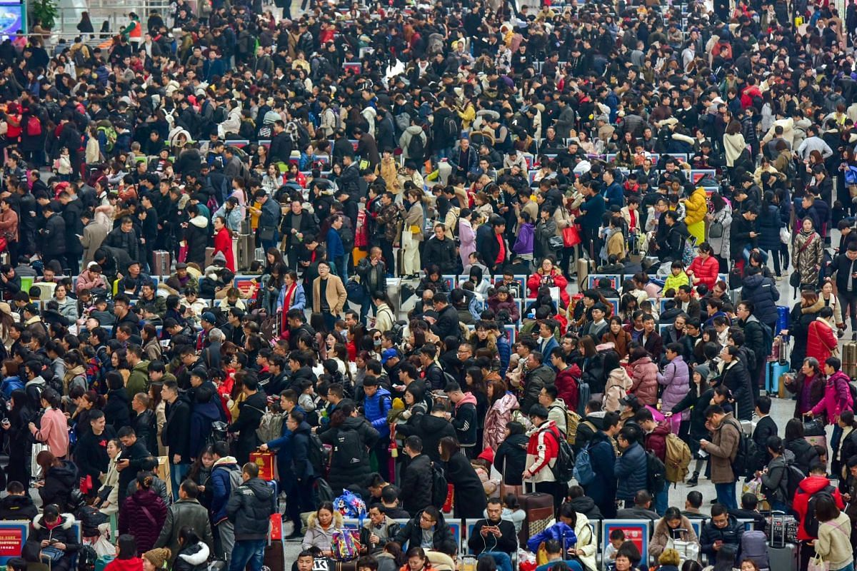 Passengers travelling during the Spring Festival travel rush ahead of Chinese Lunar New Year wait to board trains at the Hangzhou East Railway Station in Zhejiang province, China January 30, 2019. PHOTO: REUTERS