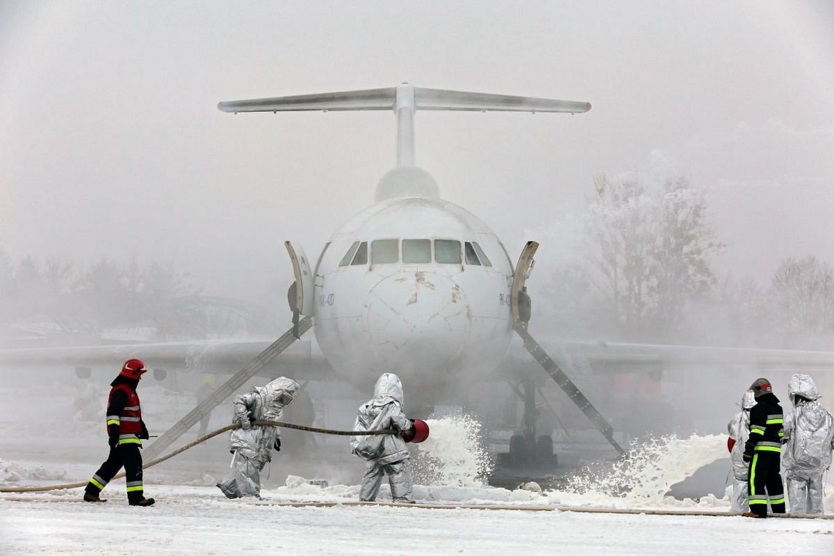 Firefighters take part in a fire drill held to showcase response efforts to an emergency landing scenario at the Lviv Danylo Halytskyi International Airport on 31 January 2019, in Ukraine, Lviv. PHOTOH: UKRINFORM/DPA
