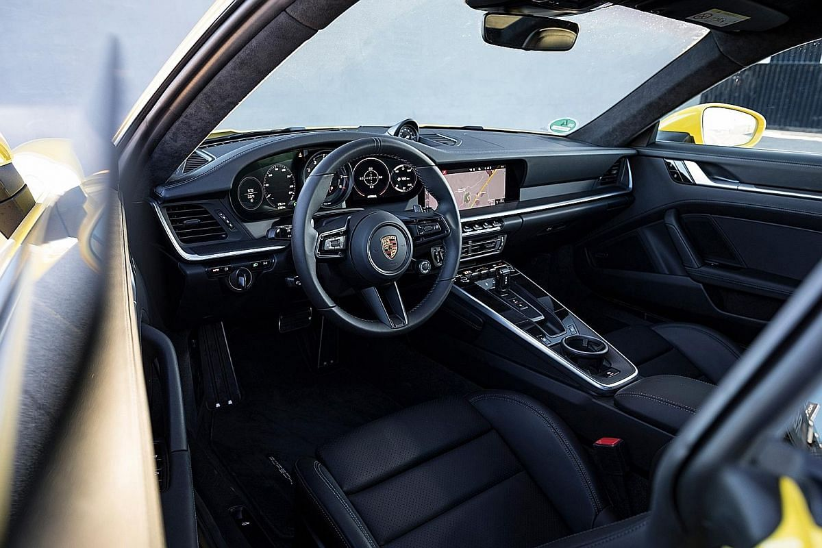 For the first time on a Porsche 911, there is keyless ignition - firing up the car involves turning a rotary lever next to the steering column.