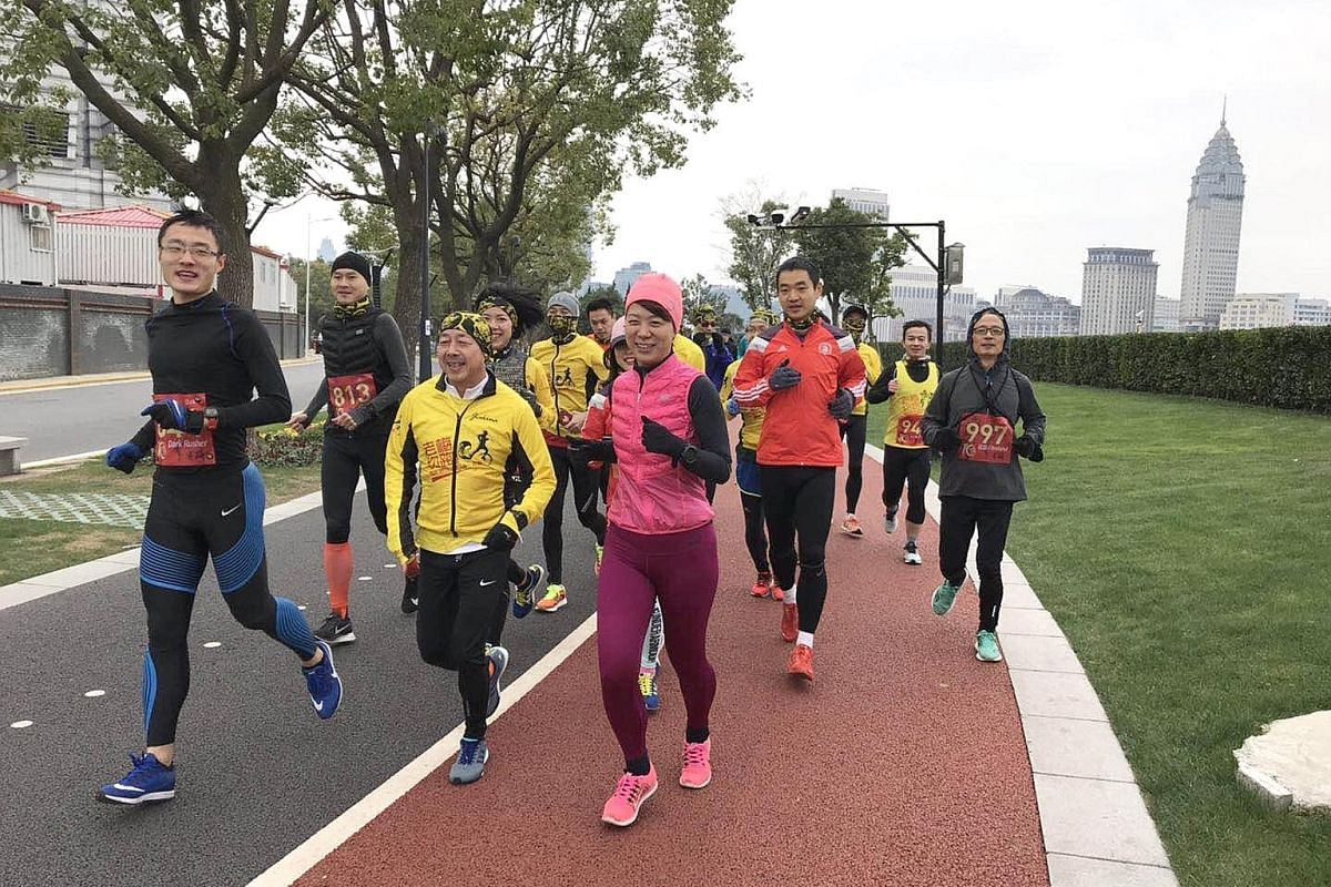 """Mr Paul Mui (front row, in yellow), originally from Hong Kong, is the founder of the running group Lao Mei - which means """"Old Mr Mui"""" - in Shanghai. Pao tuan, or running groups, in China play a big part in spreading the popularity of the sport. They"""
