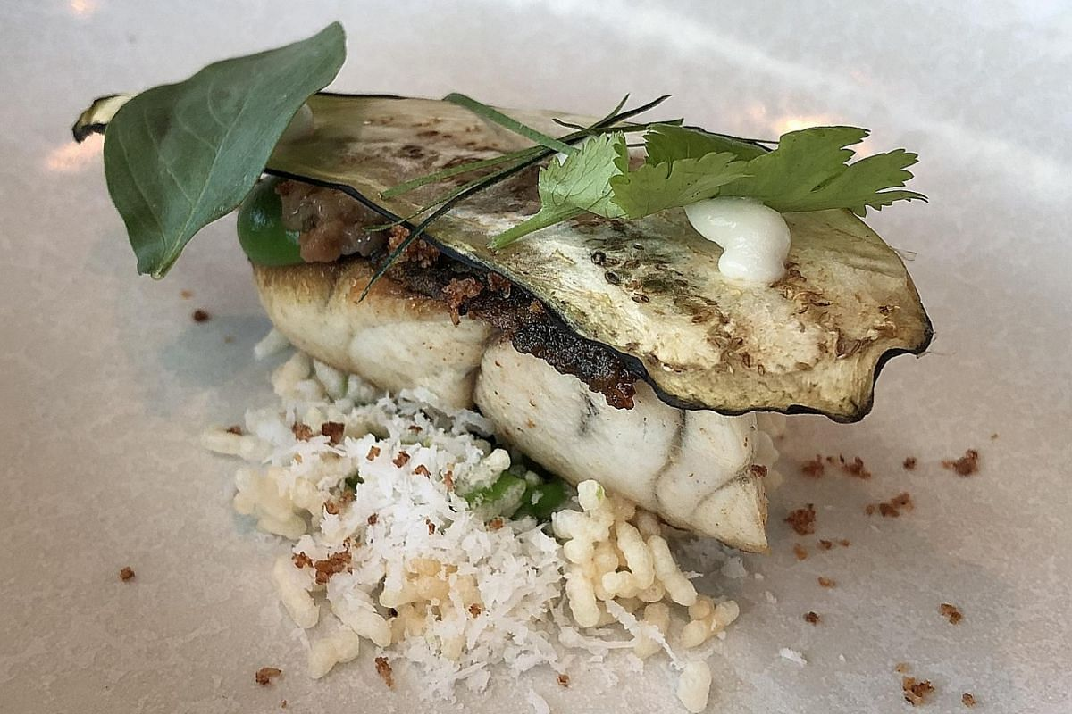 Standout dishes include Air Baguette, The Textured Tutti Frutti and Roast Barramundi (above).
