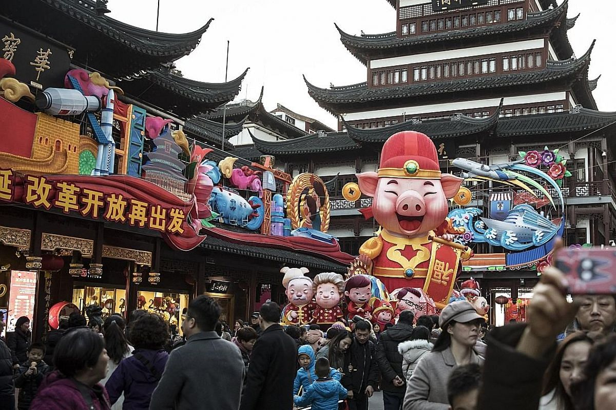 Festive decorations at Yuyuan Garden in Shanghai last Monday, ahead of the coming Chinese New Year. Previous years of the Boar have marked major turning points for stock markets, says veteran investor Gabriel Yap.