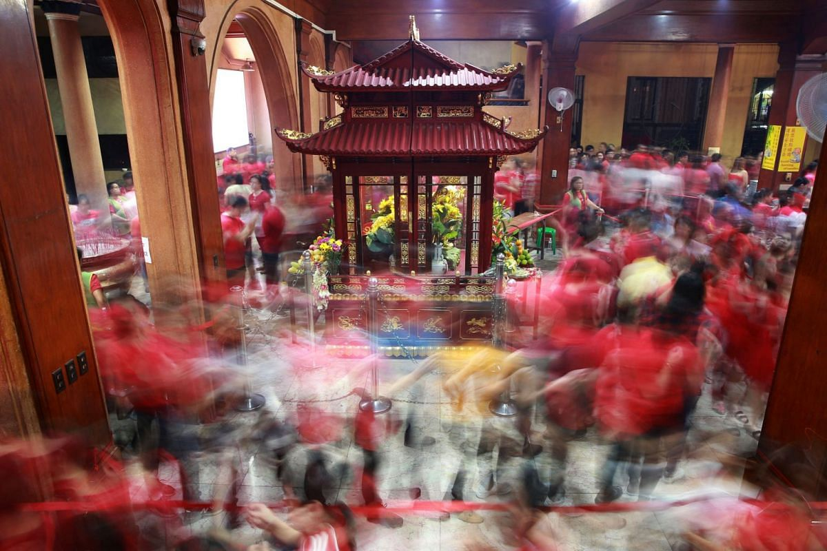 Members of the Chinese community offer prayers during Chinese New Year at a temple in Binondo, Manila, Philippines, on Feb 5, 2019.
