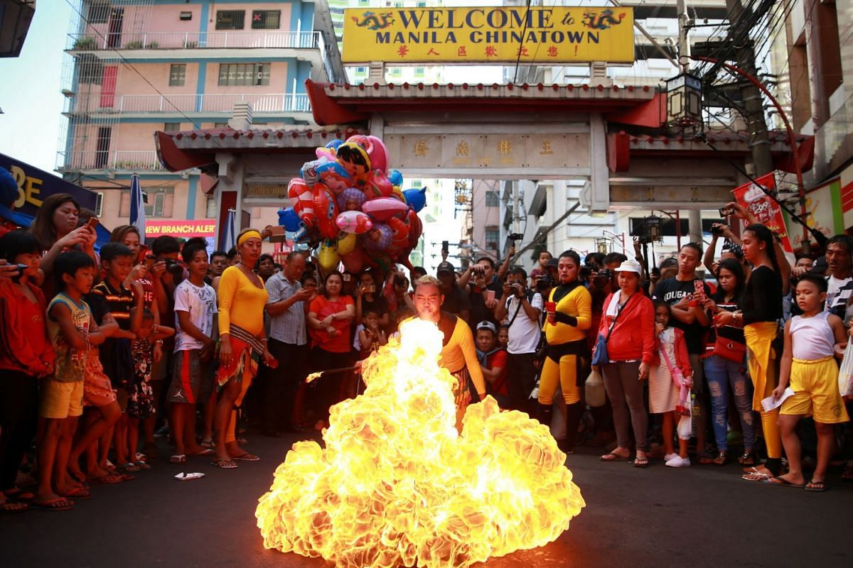 A performer blows fire during Chinese New Year celebrations at Manila's Chinatown, Binondo, Philippines, on Feb 5, 2019.