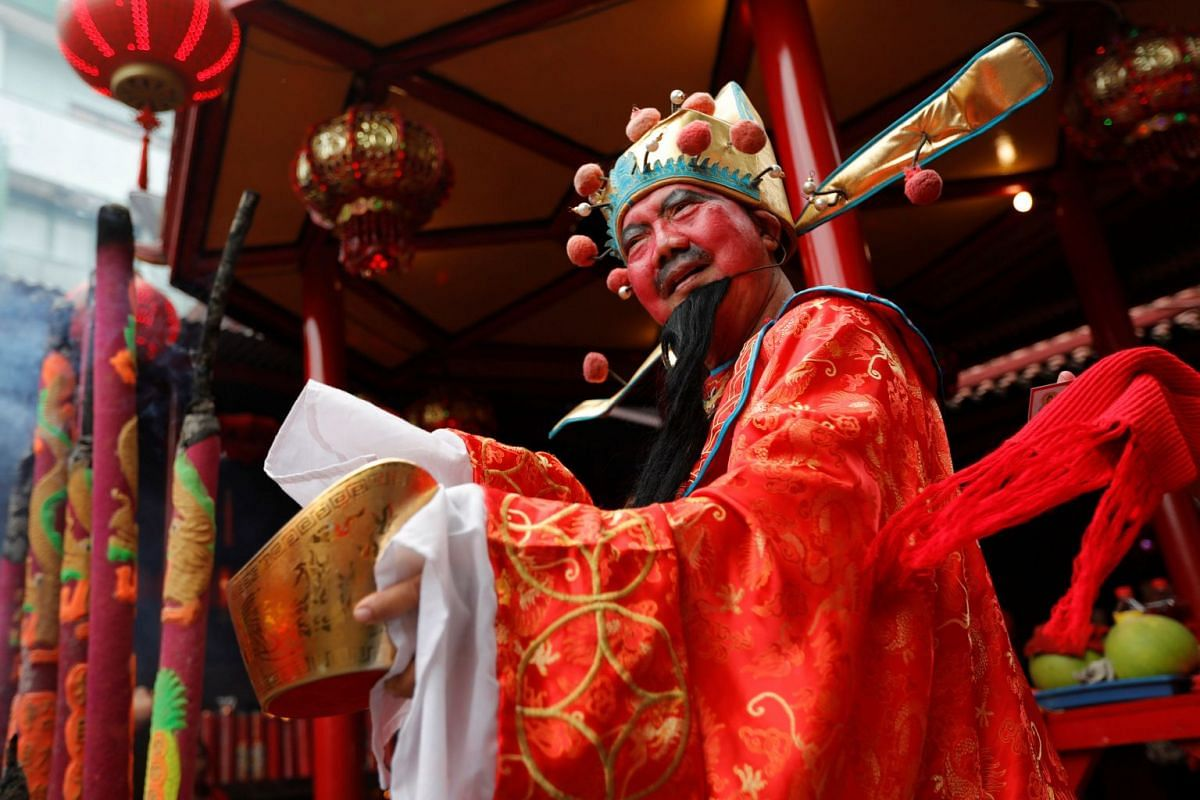 A man wears costume of the God of Fortune called Chai Sen Ye during celebrations of the Chinese Lunar New Year of the Pig at Dharma Bhakti temple in Jakarta, Indonesia, on Feb 5, 2019.