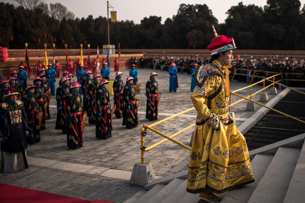 Chinese performers dressed in traditional costumes perform a reenactment of a Qing dynasty (1636-1912) imperial sacrifice ritual to worship the Earth, to mark the first day of the Chinese New Year, at Ditan Park in Beijing, China, on Feb 5, 2019.