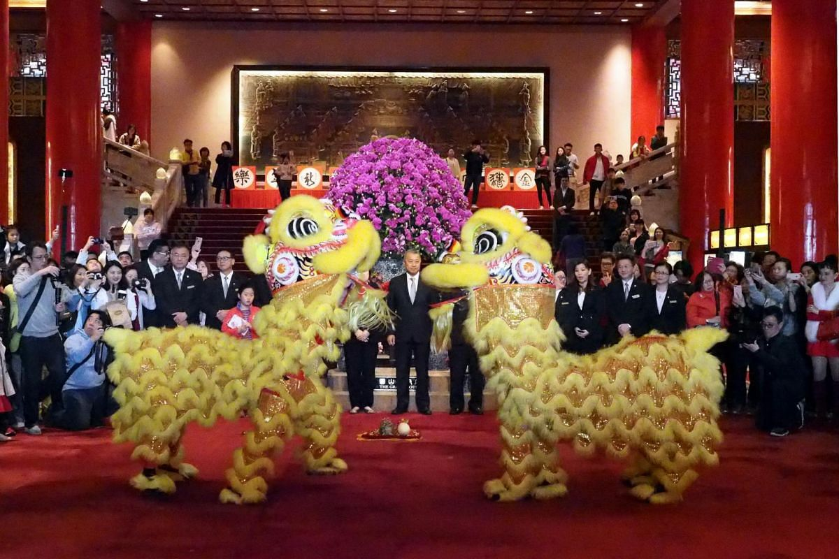 Lion dancers perform for tourists during Chinese Lunar New Year celebrations at the Grand Hotel in Taipei, Taiwan, on Feb 5, 2019.