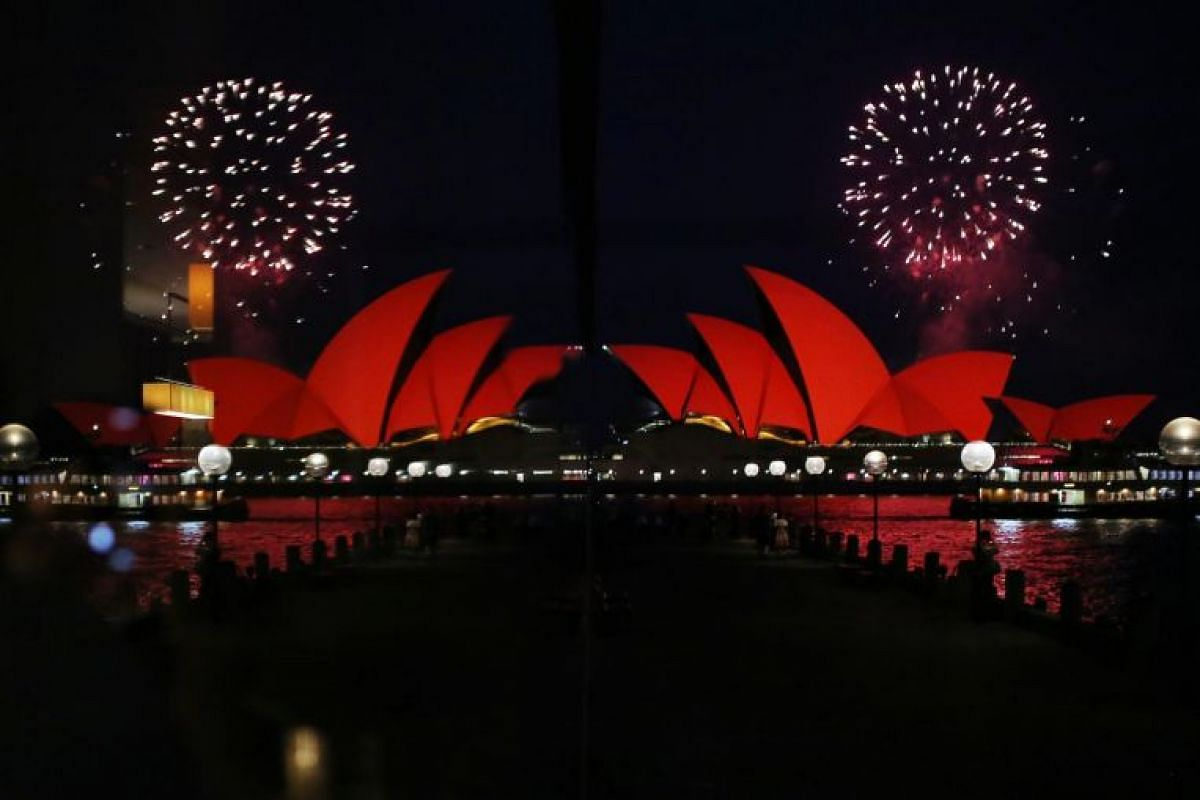 The Sydney Opera House is illuminated in red as part of celebrations for Chinese New Year of the Pig, on Feb 4, 2019.