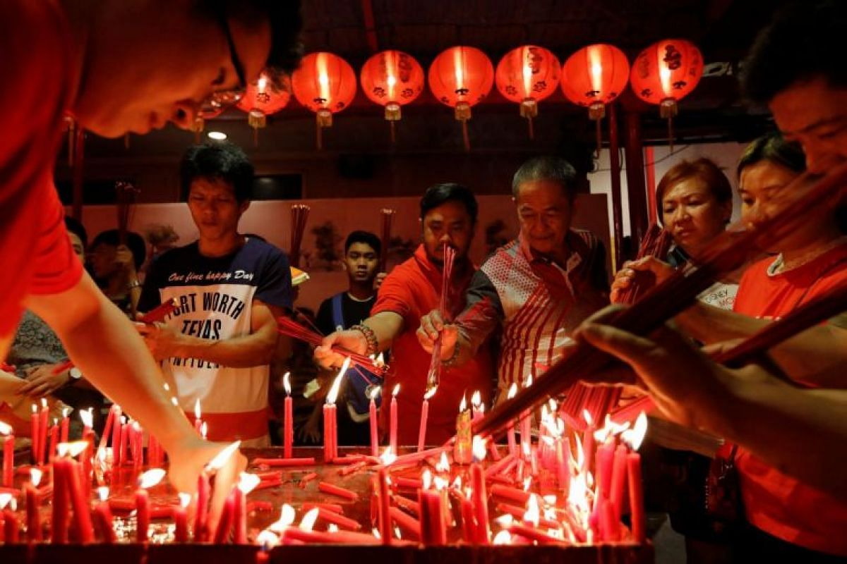 Ethnic Chinese Indonesians light incense sticks during Chinese New Year's eve at Dharma Bhakti temple in Jakarta, Indonesia, on Feb 4, 2019.