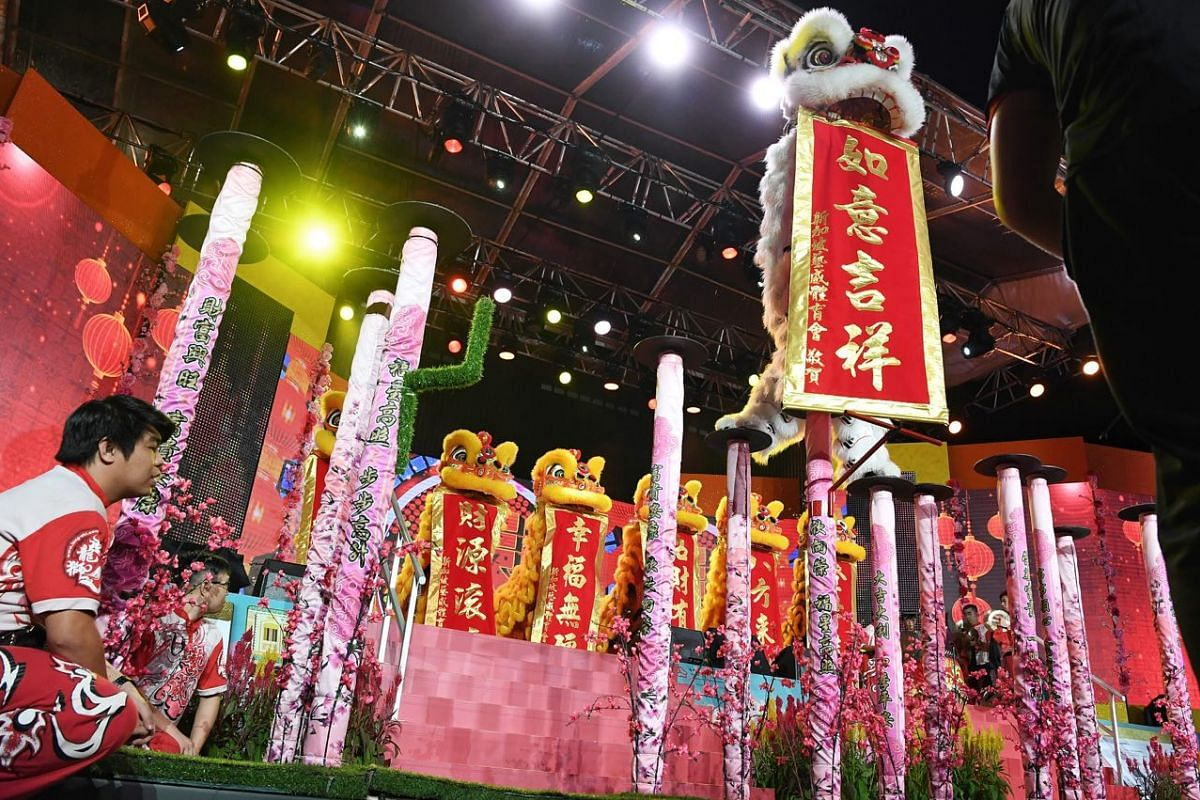 Visitors enjoy a performance by the Singapore Yi Wei Athletic Association at the Chinese New Year countdown in Chinatown.