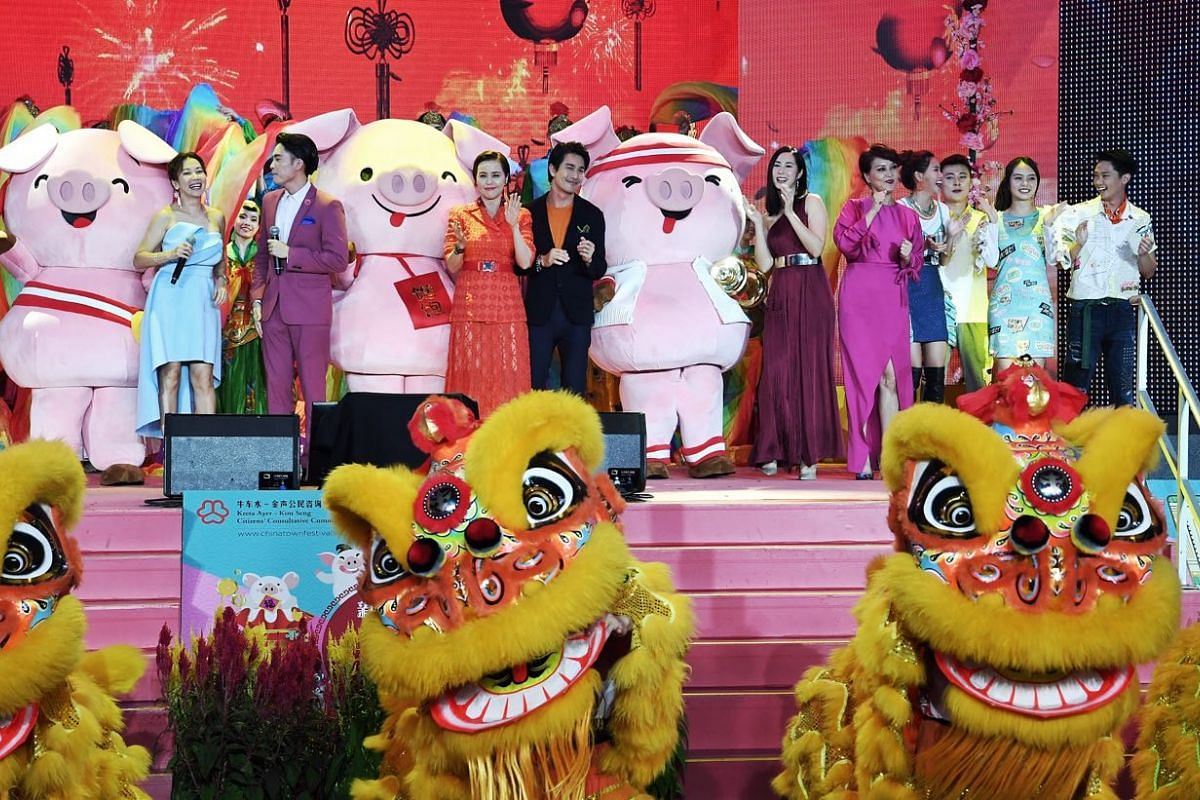 Visitors enjoy a performance by Mediacorp artists at the Chinese New Year countdown in Chinatown.