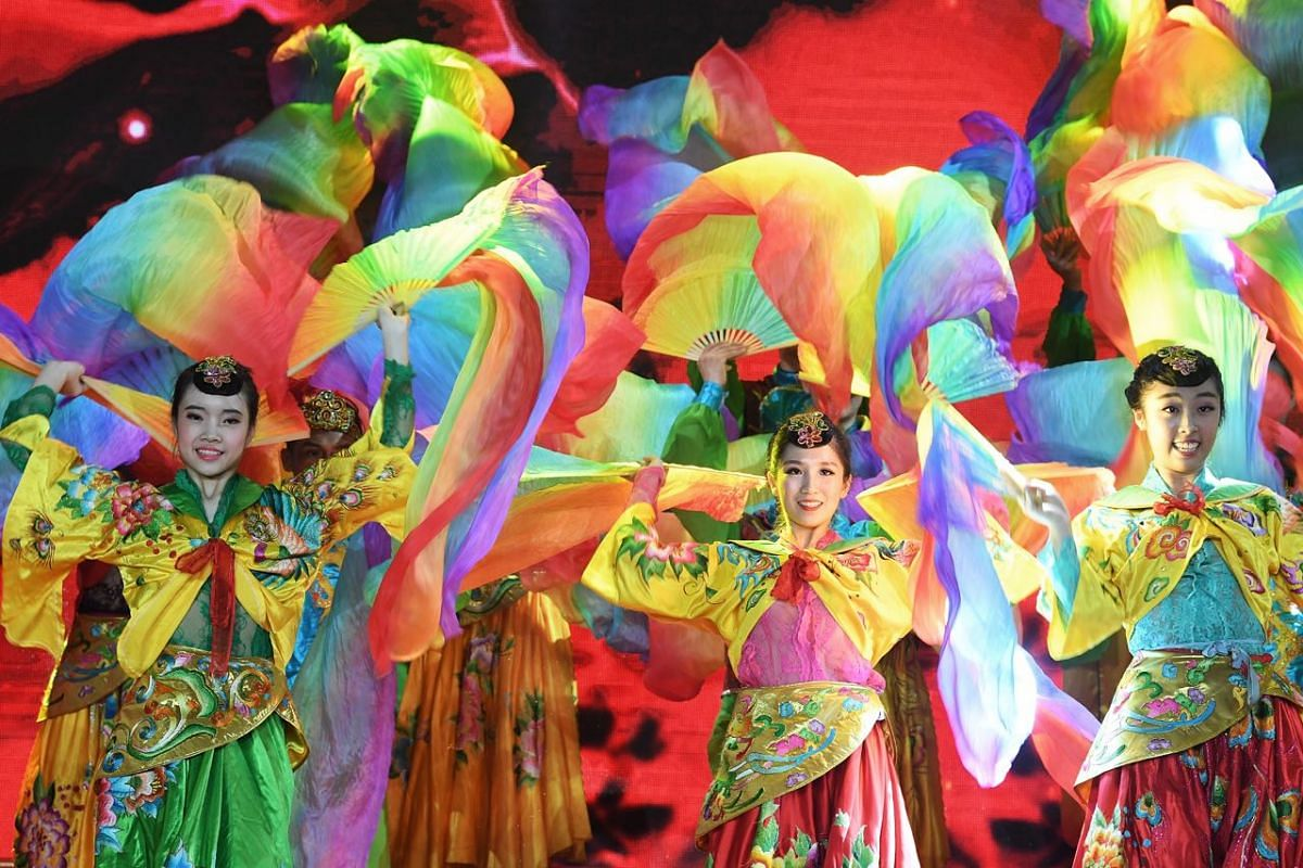 Visitors enjoy a dance performance by the Dance Ensemble Singapore at the Chinese New Year countdown in Chinatown.