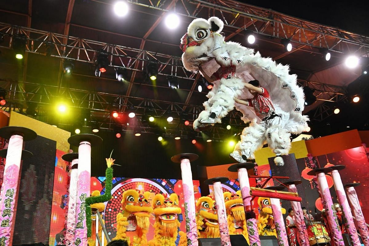 Visitors enjoy a lion dance performance by the Singapore Yi Wei Athletic Association at the Chinese New Year countdown in Chinatown.