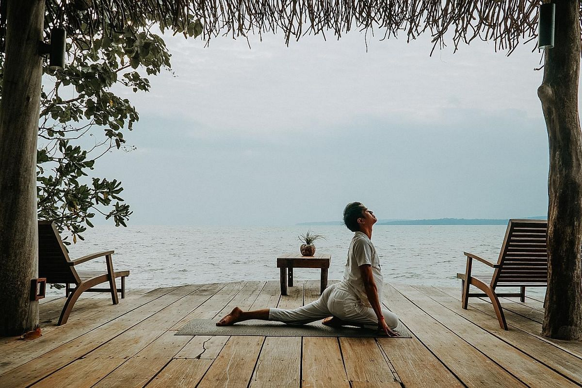 Activities at Song Saa include morning yoga classes by the sea.