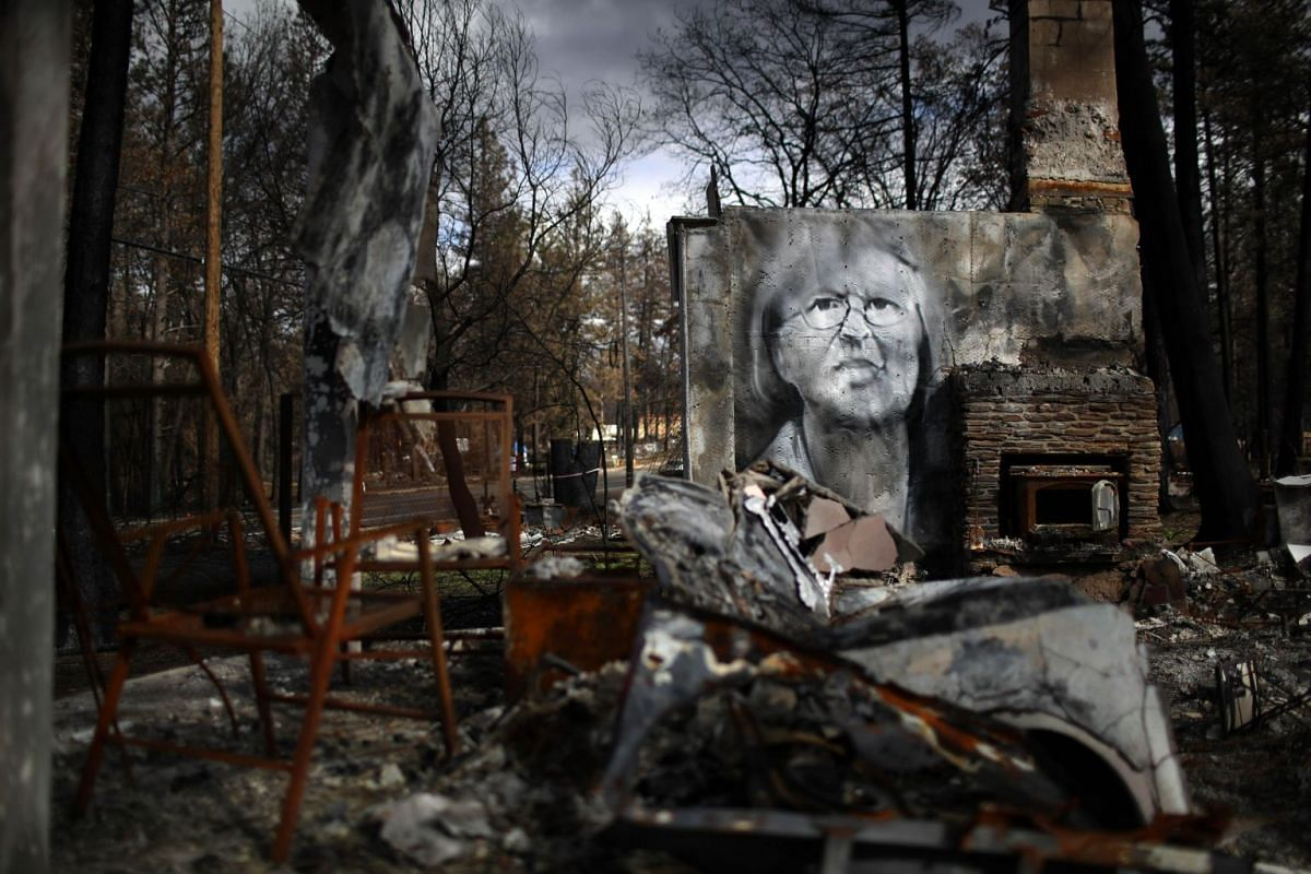 A woman who died in the blaze is commemorated on the remains of a home.