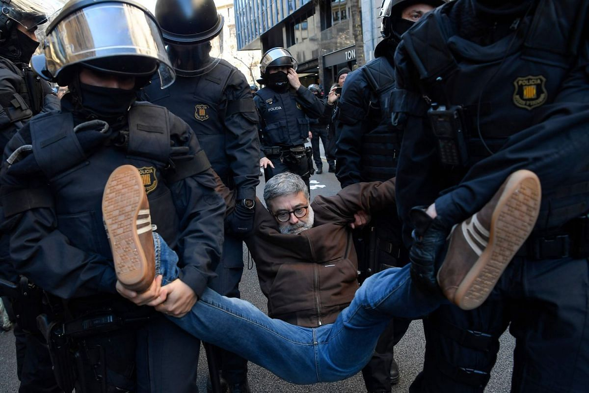Catalan regional police forces Mossos d'Esquadra carry Catalan regional MP Carles Riera of the Candidatura d'Unitat Popular - CUP (Popular Unity Candidacy) after he joined demonstrators blocking a street in Barcelona to protest against the trial of f