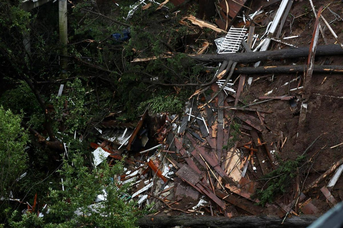 A view of debris that was left in the wake of a home that was swept down a hill by a mudslide in Sausalito.
