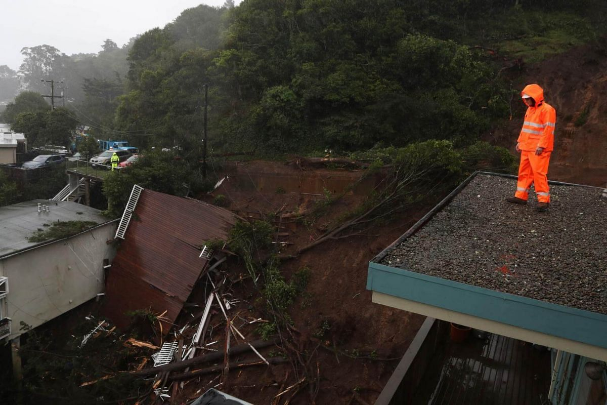 A view of the roof of a home that was swept down a hill by a mudslide in Sausalito.