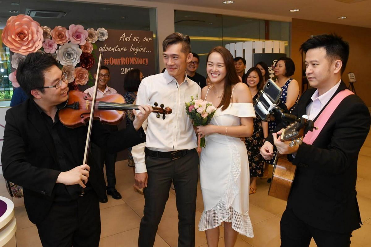 Groom Pang Sze Hou and bride Wu Xuele tie the knot at the Registry of Marriages in Singapore on Valentine's Day.