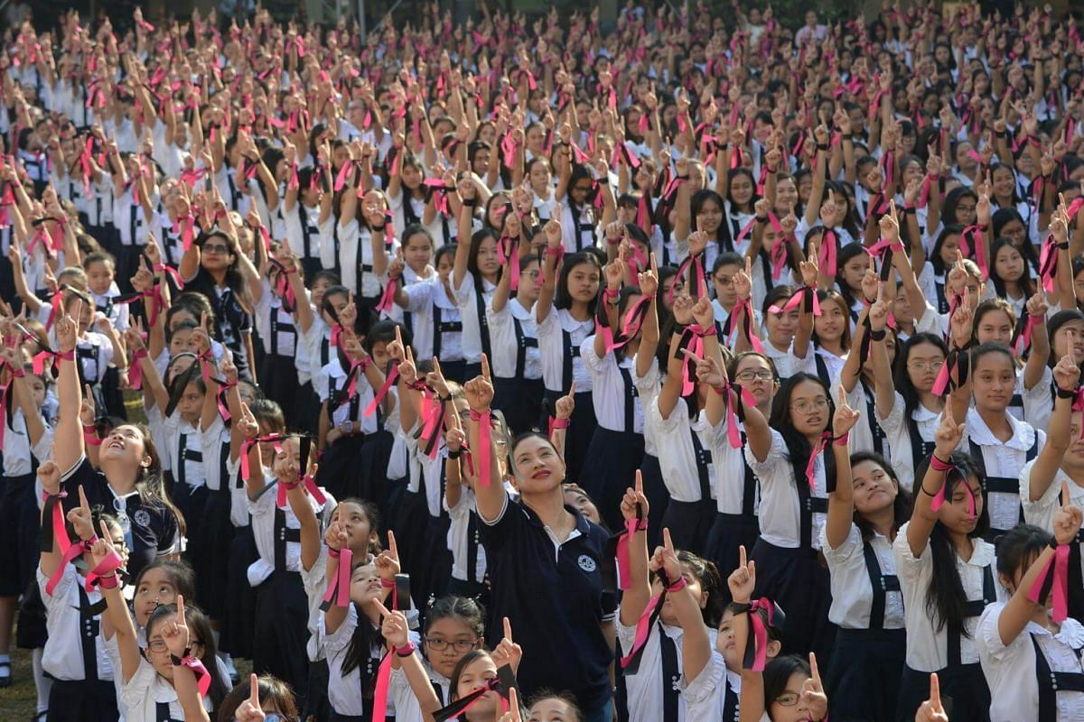 Students from St Scholastica's College in Manila gesture as they take part in the One Billion Rising global movement on Feb 14, calling for an end to discrimination and violence against women and children.