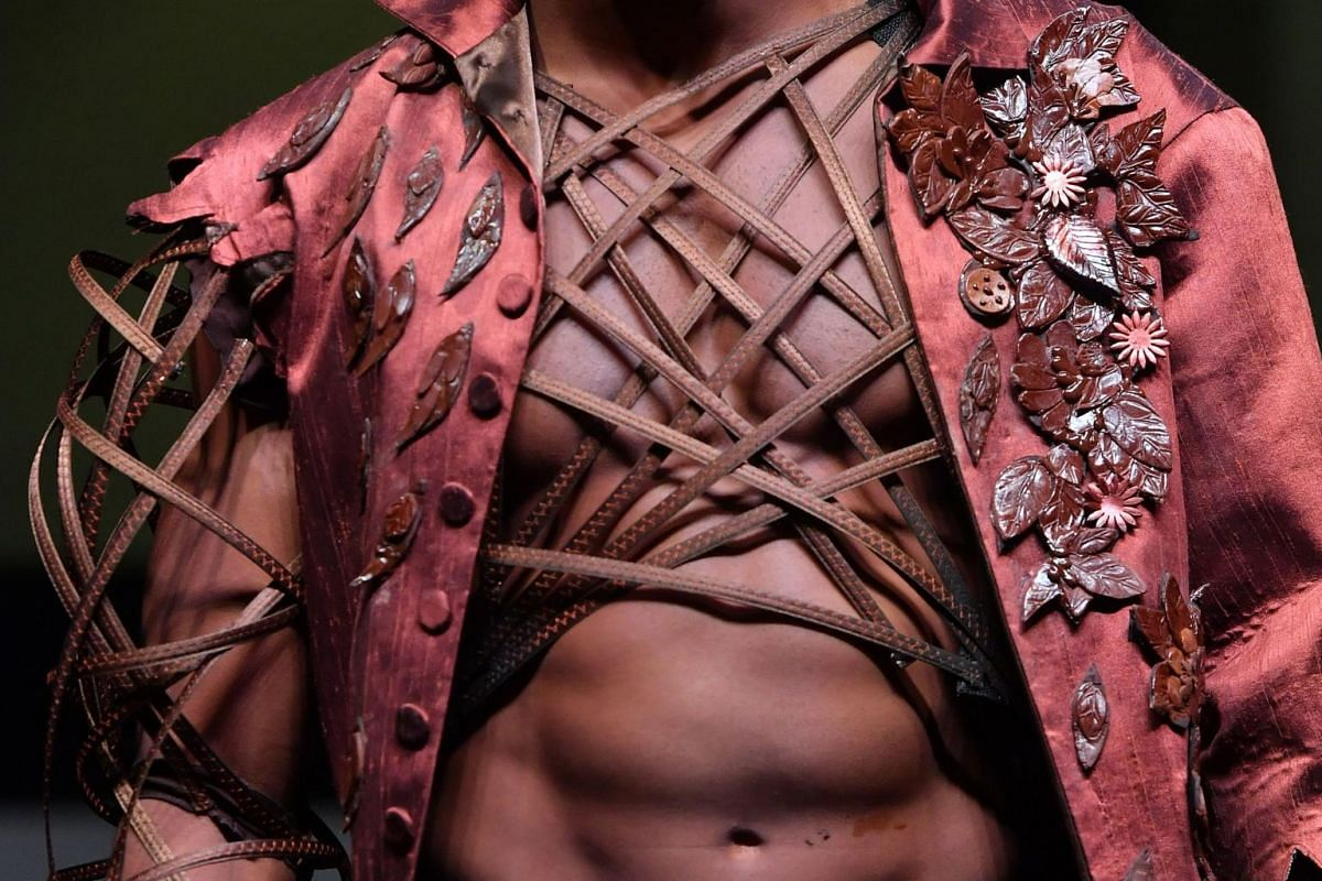 A model presents a chocolate outfit during a fashion show of clothes made out of chocolate for the inaugural night of the sixth Chocolate Fair in Brussels, on Feb 21, 2019.