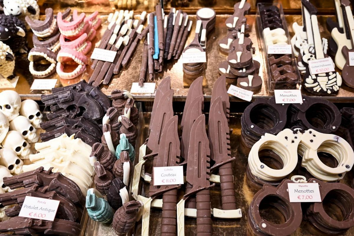 Chocolate creations representing novelty weapons are on display at the sixth Chocolate Fair in Brussels, on Feb 21, 2019.