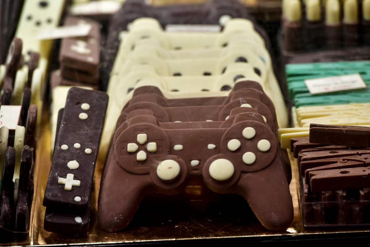 Chocolate creations representing game controllers are on display at the sixth Chocolate Fair in Brussels, on Feb 21, 2019.