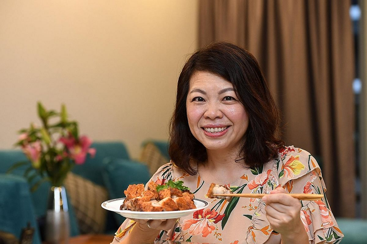 Ms Candice Ong serves her roast pork belly with hand-pounded chilli sauce.